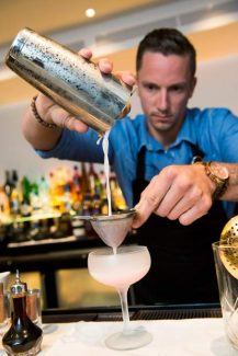 "Anthony Bohlinger strains a drink at the Chefs Club, located inside the St. Regis Aspen Hotel. Bohlinger is the new executive beverage director at the Chefs Club. He won the regional Bombay Sapphire and GQ Magazine sponsored ""Most Imaginative Bartender in America"" contest on Aug. 12 and will travel to Las Vegas in September to compete in the finals."