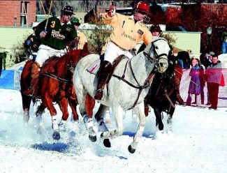 Riders and ponies playing for L'Hostaria and Hotel Colorado compete in the 5th annual World Snow Polo Championship at Wagner Park. Aspen Times photo/Mark Fox.