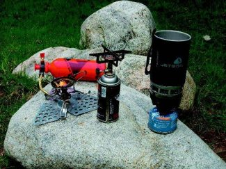 From left, the MSR WhisperLite, the Honeybird Top-Gun and the winning JetBoil Personal Cooking System. C.K. photo.