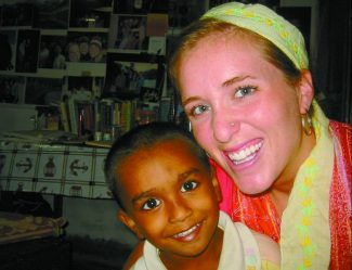 Peace Corps volunteer Jill Evans with her host brother, Omul. Evans spent two years in Bangladesh before evacuating in April because of terrorist threats. (Courtesy Jill Evans)