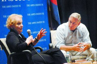 Mark Fox/The Aspen TImes Former Secretary of State Madeleine Albright joins Aspen Institute President Walter Isaacson on stage Friday at Paepcke Auditorium.