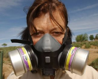 Karen Trulove of Silt says she wears a respirator when fumes from a nearby natural gas storage and pumping station drift over her property. (Peter M. Fredin/AP)