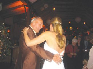 Paul Copsey dances with his granddaughter, Terri Dangler, at her wedding Saturday shortly before collapsing at the festivities. Guests performed CPR on Copsey, who later was joking with the nurses at Aspen Valley Hospital. (Contributed photo)