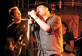 Blues Traveler, with singer John Popper, front, and guitarist Chan Kinchla, released Cover Yourself, an album with drastically reworked versions of their old songs, in October. The band plays a free show Saturday at the base of Aspen Mountain. (Stewart Oksenhorn/The Aspen Times)