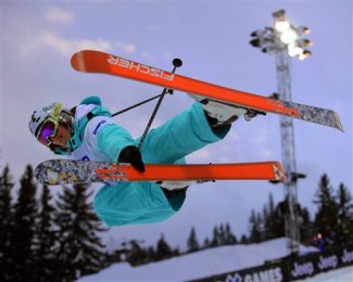 Jen Hudak of Park City, Utah grabs her ski while flying in the air out of the Superpipe during the women's Skiing Superpipe competition on Friday, Jan., 25, 2008 at the Winter X Games at Buttermilk Ski Area near Aspen, Colo.  Hudak won her competition.  (AP Photo/Nathan Bilow)