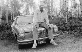 Morgan SmithThis photo from the late 1970s shows Mike Strang and his Mercedes Benz, with its memorable license plate.