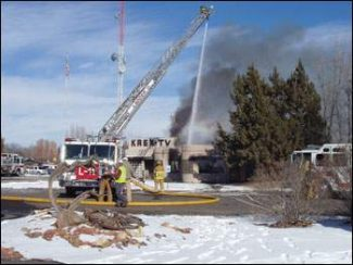 Grand Junction firefighters battle a blaze Sunday at the building housing KREX-TV. The cause of the fire is under investigation. (Paul Shockley/Free Press)