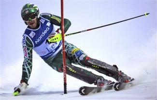 Bode Miller of the United States clears a gate  during the first run of an alpine ski, men's World Cup Slalom, in Levi, Finland, Sunday, Nov. 15, 2009. (AP Photo/Giovanni Auletta)