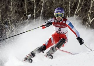 Ski racer Sarka Zahrobska, of the Czech Republic, slams past a gate in the first run of the World Cup Slalom ski race on Sunday, Nov. 29, 2009, in Aspen, Colo. (AP Photo/ Nathan Bilow)