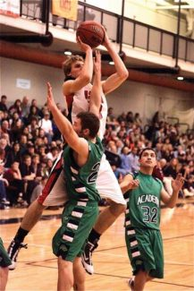 Jim Ryan/Special to The Aspen TimesAspen guard Andrew Papenfus shoots over an Academy defender during March 5's sub-region game at Aspen High School.