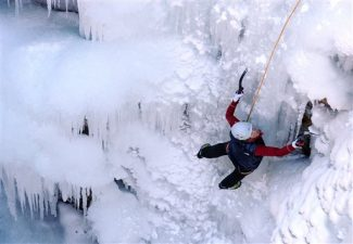 In this photo taken Jan. 8, 2011, a climber makes her way up an ice wall during the 2011 Ouray Ice Festival Saturday, Jan. 8, 2011, in the Ouray, Colo.,  The daunting nature of the sport, pulling yourself up a slick, frozen surface that can break loose at any time,   meant that until recently, the handful of waterfalls in the Pikes Peak region that could be climbed in winter mostly weren't.   (AP Photo/The Colorado Springs Gazette, Christian Murdock)