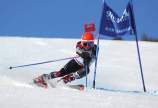 Randy Wagner SharpShooter ImagingThe Aspen Valley Ski and Snowboard Club's Andrew Hancock rounds a gate en route to a second-place finish in giant slalom at March's Rocky/Central Division J3 Junior Olympics at Buttermilk.