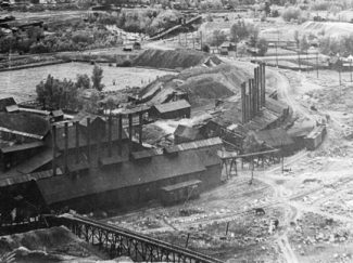 Willoughby CollectionThe numerous steam-boiler smokestacks for the Smuggler Mine suggest the amount of power it took to pump water from great depths, an expensive proposition.