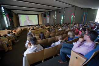 Aspen Ideas Festival patrons watch former President Bill Clinton speak in Paepcke Auditorium on the campus of the Aspen Institute Saturday. (Patrick Ghidossi/The Aspen Times)
