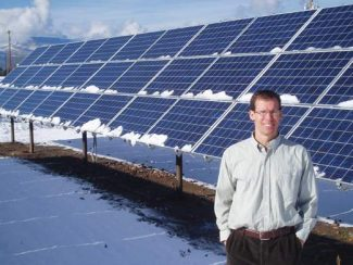 Aspen Times filePaul Spencer of Clean Energy Collective, with the small solar-energy array his firm created in El Jebel. Solar projects in Colorado Springs and Telluride are next.