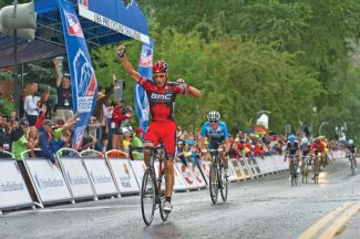 George Hincapie of BMC Racing celebrates winning the Queen Stage of the USA Pro Cycling Challenge as he crosses the finish line in downtown Aspen on Wednesday afternoon. Tejay Van Garderen finished in second place for the stage and took the overall lead in the race. (Patrick Ghidossi/The Aspen Times)