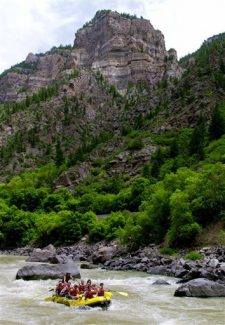 Rafters ride whitewater on the Colorado River during a rafting trip in Glenwood Canyon outside of Glenwood Springs. Waterways in the Aspen, Summit County and Vail areas are beginning to taper off, local guides say.
