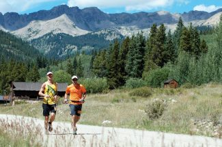 Contributed photoZeke Tiernan, right, helps pace Dylan Bowman in last summer's Leadville Trail 100.