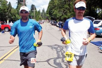 Contributed photoZeke Tiernan, left, and pacer Jeremy Duncan head out of the Foresthill Aid Station at mile 62 during Saturday's Western States 100 in California.
