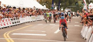 Jim Ryan/Aspen Times fileTom Danielson wins the Queen Stage of this year's USA Pro Cycling Challenge, crossing the finish line in downtown Aspen. The VIP tent and crowd lines the street to the left.