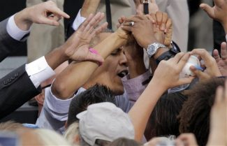 President Barack Obama greets supporters after speaking at a campaign rally at City Park on Wednesday, Oct. 24, 2012, in Denver. (AP Photo/Ed Andrieski)