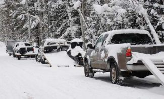 Janet Urquhart/Aspen Times fileSnowmobiler parking in Lenado, a small community east of Woody Creek, will continue this winter. A district court judge has declined to issue an injunction sought by landowners to halt the practice.