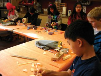 Wyly Community Arts Center/courtesy photoThird-graders from Basalt Elementary School art teacher Lois Devine's class work on sculptures at the Wyly Community Arts Center. The arts center has solidified its place as a community asset since moving to a visible location at the former Basalt library.