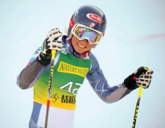 Mikaela Shiffrin, of the United States reacts in the finish arena after her run in the women's World Cup giant slalom in Aspen, Colo., on Saturday, Nov. 24, 2012. Shiffrin finished ninth. (AP Photo/Nathan Bilow)