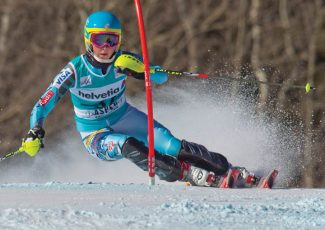 Mikaela Shiffrin, of the United States, passes a gate during the women's World Cup slalom ski competition in Aspen, Colo., on Sunday, Nov. 27, 2011. (AP Photo/Nathan Bilow)