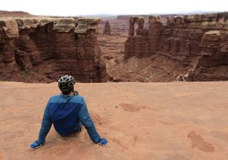 Bob WardA rider takes a break on the White Rim Trail to check out Monument Basin. Odd rock formations and towering buttes call for attention as riders pedal along the 100-mile route.