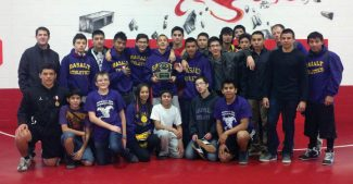 Contributed photoMembers of the Basalt High wrestling team pose for a photo Saturday after finishing second in a season-opening tournament in Hotchkiss.