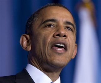 """FILE - This Dec. 5, 2012 file photo shows President Barack Obama speaking at the Interior Department in Washington. The president says he won't go after Washington state and Colorado for legalizing marijuana. In a Barbara Walters interview airing Friday on ABC, Obama is asked whether he supports making pot legal. He says, """"I wouldn't go that far.""""   (AP Photo/Carolyn Kaster, File)"""