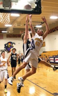 Jim RyanLonghorns guard Dylan Rakowski is fouled by a Vail Mountain School player while driving to the basket Friday at Basalt High School.