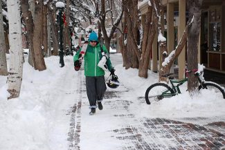 Janet Urquhart/The Aspen TimesA lone skier makes his way through downtown Aspen Tuesday morning. Light snow overnight added another layer of fluff to town.