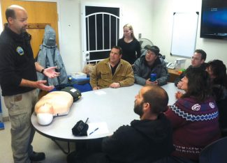 Contributed photoAspen Ambulance District operations manager Gabe Muething provides automated external defibrillator training on Thursday afternoon to city Water Department employees, clockwise from left, Keith Wester, Valerie Forbes, Steve Wilson, William Carp, Lee Ledesma, Karen McConnell and Michael Tontis.