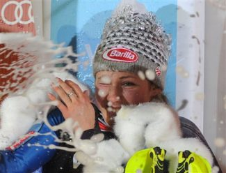 Mikaela Shiffrin, of the United States, celebrates with champagne on the podium after winning an alpine ski, women's World Cup slalom, in Zagreb, Croatia, Friday, Jan. 4, 2013. (AP Photo/Giovanni Auletta)