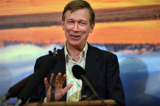 Gov. John Hickenlooper talks about Amendment 64 at the State Capitol in Denver, Monday, Dec. 10, 2012. Marijuana for recreational use became legal in Colorado Monday, when Hickenlooper took a purposely low-key procedural step of declaring the voter-approved change part of the state constitution. Hickenlooper, a Democrat, opposed the measure but had no veto power over the voter-approved amendment to the state constitution. (AP Photo/The Denver Post, Craig F. Walker) MAGS OUT; TV OUT; INTERNET OUT