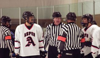 Michael Appelgate/The Aspen TimesAspen's Willy Doremus, left, questions a call during Friday's game against Columbine at Lewis Ice Arena.