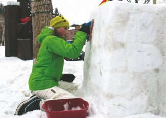 "Jeanne McGovern/The Aspen TimesAspen Community School student Melody Lemke scrapes away ice to help create a sculpture of an old-fashioned car during Kidsculpt on Friday. Her team received the ""most original"" award for its efforts."