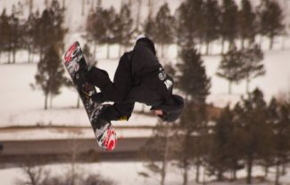 Jim Ryan Maxence Parrot re-enters the slopestyle course at Buttermilk on his way to a silver X Games medal Saturday.