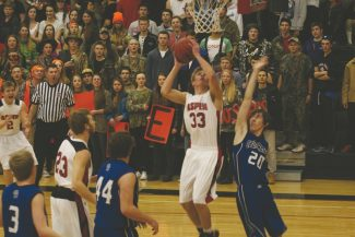 Leah Moriarty Aspen High School junior Clayton Crawford hits a put-back basket to help the Skiers beat Cedaredge, 66-38, before a large home crowd Thursday night. Crawford led all scorers with 20 points.