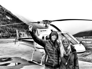 Contributed photoSlopestyle skier extraordinaire Meg Olenick, of the Roaring Fork Valley, gets ready to board the helicopter in British Columbia with Kristin Leskinen.