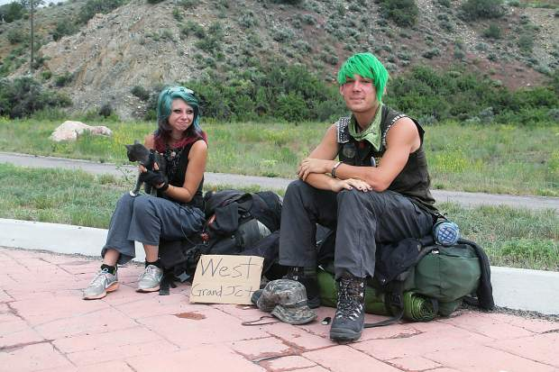 Lauren Greenfield and Keenan Bessewer of Florida were hitchhiking west Thursday but were unable to catch a ride past Dotsero due to the I-70 closure.
