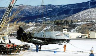 Three Mexican pilots were aboard this Bombardier Challenger 600 aircraft that crashed upon landing at the Aspen-Pitkin County Airport Sunday afternoon. On Tuesday, the jet was lifted from the tarmac in front of the Airport Operations Center on Owl Creek Road. According to Dustin Havel, assistant aviation director of operations and facilities, the wreckage will be inspected by the National Transportation Safety Board and will be moved out of the area.