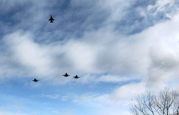 F-16s from Nellis Air Force Base in Nevada fly over Rifle High School near the end of the funeral service  Dec. 14 for Air Force Capt. Will DuBois.
