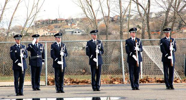 An honor guard from Peterson Air Force Base in Colorado Springs prepares for the 21-gun salute at the end of Capt. Will DuBois' funeral service  Dec. 14 at Rifle High School.