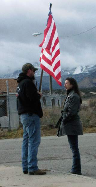 Several residents showed up with flags  Dec. 14 at Rifle High School to show support for Capt. Will DuBois and his family.