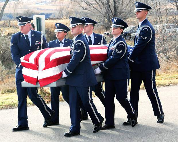 Air Force pallbearers carry the casket of Capt. Will DuBois outside of Rifle High School on Dec. 14 for final honors that included a 21-gun salute and F-16 flyover.