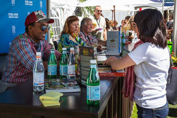 Marcus Samuelson, Claudine Pépin and Jacques Pépin sign autographs and greets fans at a Food & Wine Classic Grand Tasting Friday.