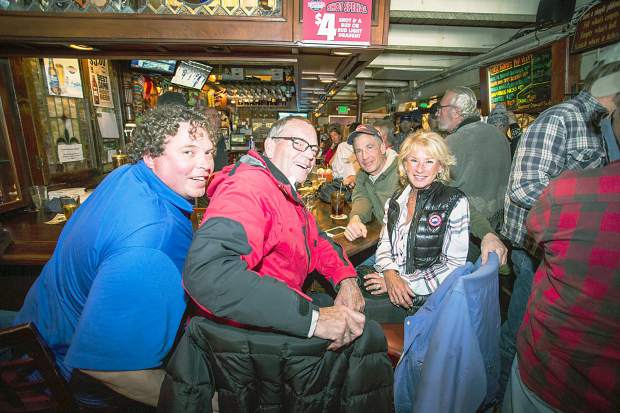 Ward Colby, Michael Lee, Pam Thompson, and Dave Martin gather around the Little Annie's bar on it's final day Sunday.